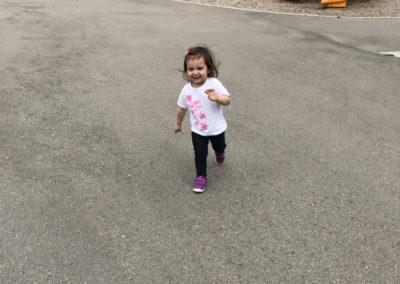 Cassandra runs around happily.